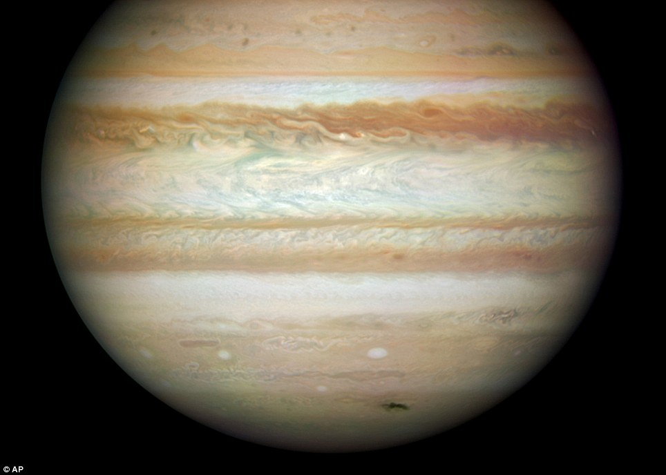 Closer to home: The planet, Jupiter. Its volume is equal to 1,317 Earths. Hubble snapped the impact zone after a collision with a possible comet. It is the dark blemish at the bottom